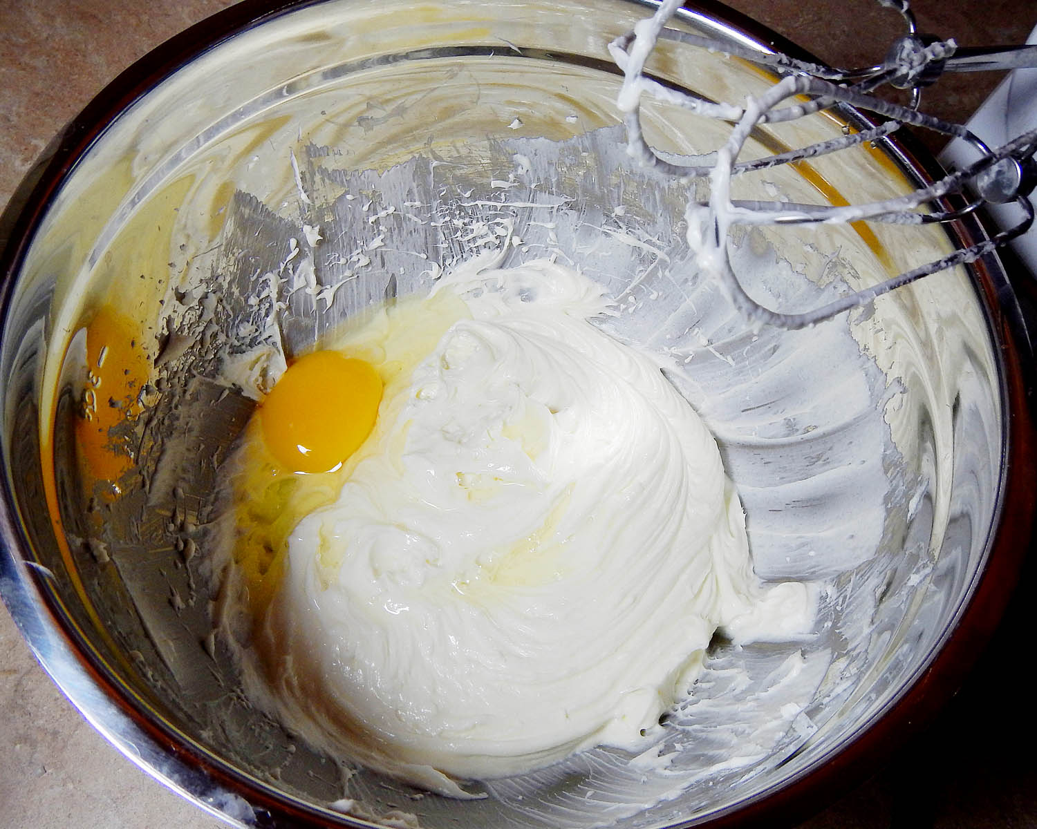An egg in cheesecake batter
