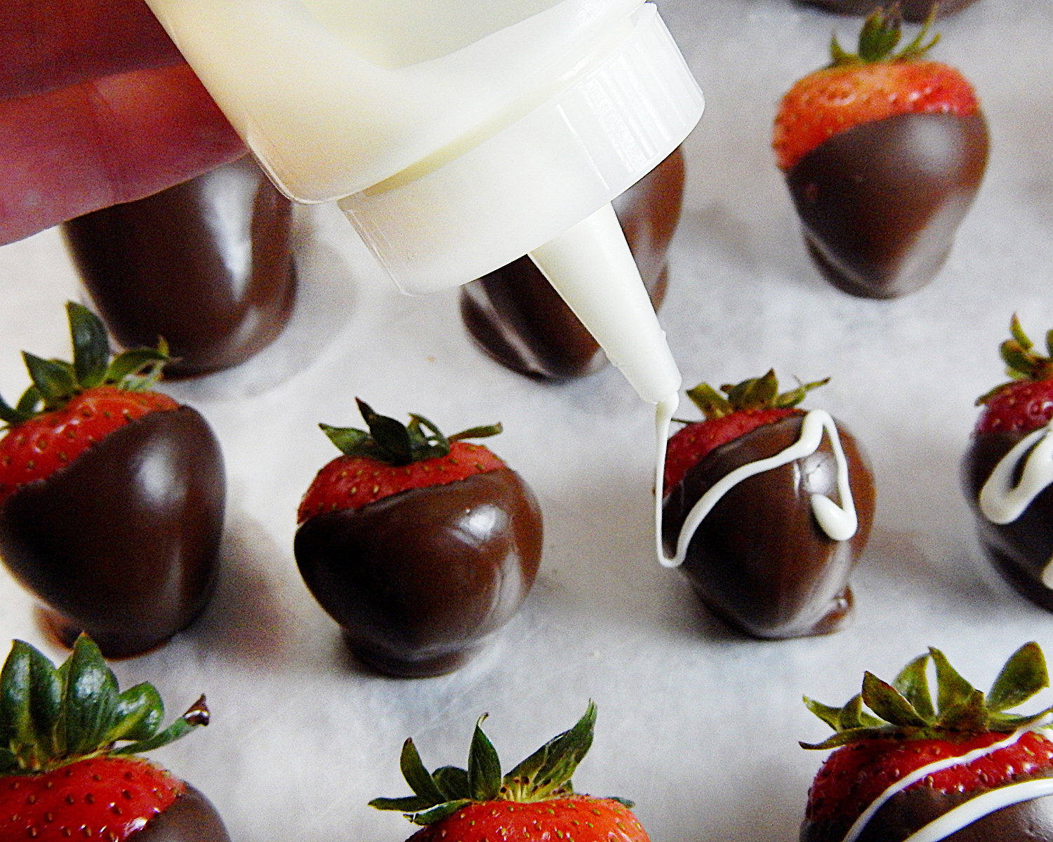 Drizzling White Chocolate on Chocolate Covered strawberries