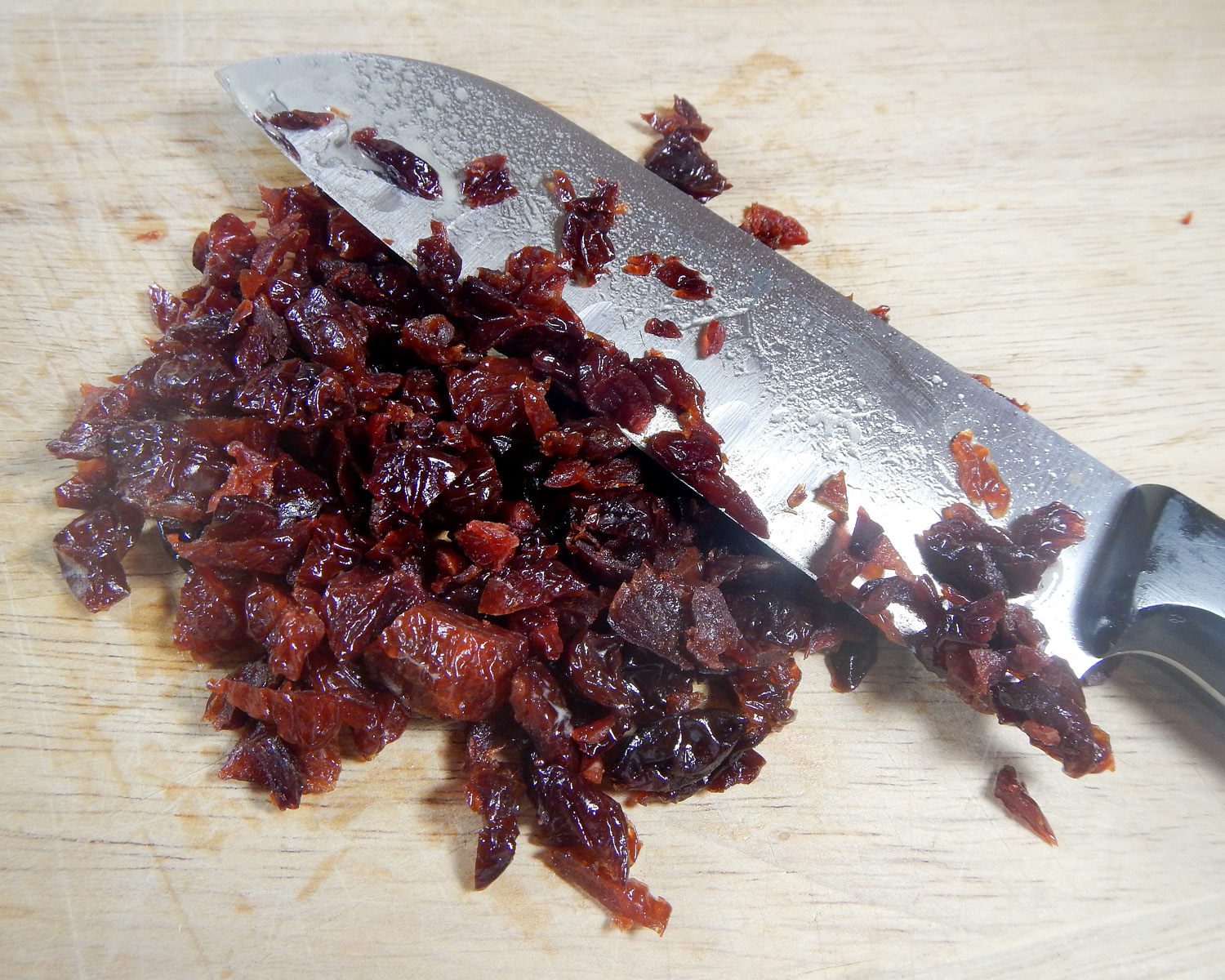 Knife Cutting Dried Cherries for Brownies